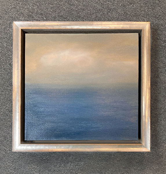 Framed Suzanne Clifford-Clark painting of ocean with clouds