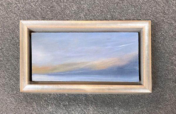 Framed Anne Garton painting of sunset on water