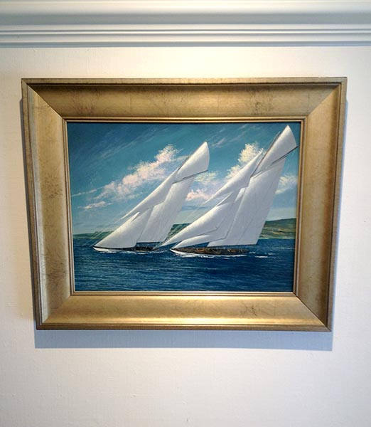 Framed Scott Duncan Racing W Class small sailing boat on water