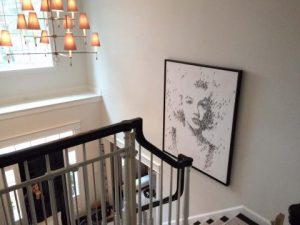 Craig Alan populous painting of Marilyn Monroe Hanging over staircase