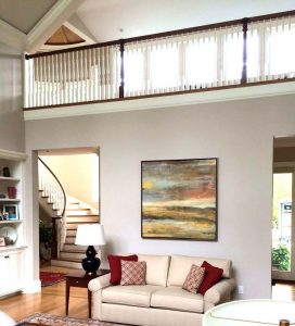 Helen Zarin painting hanging over couch in Westwood great room