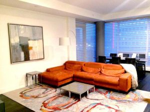 Photo of abstract Ursula Brenner painting hanging in a modern Boston condo