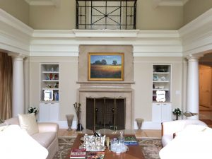 Traditional landscape painting hanging in a formal Concord, MA home
