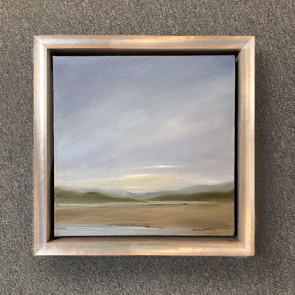Framed Anne Garton painting of a cloudy sky over hills and valley