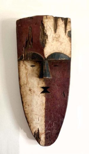 Colorful African wooden mask from fang tribe cameroon