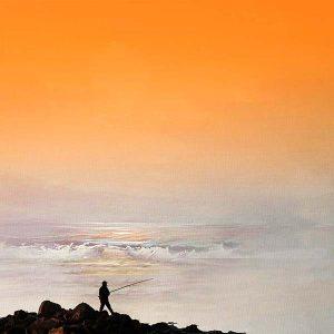 Photo of man fisherman standing on ocean rocks