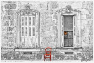 Photo of old building with red chair
