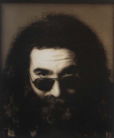Herb Greene - Jerry 79 photo of Jerry Garcia circa 1979 peering over his sunglasses