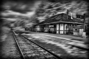 black and white photo of old railroad station