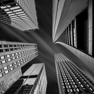 Stephen Rostler Black and White Photo of Skyscrapers from Below