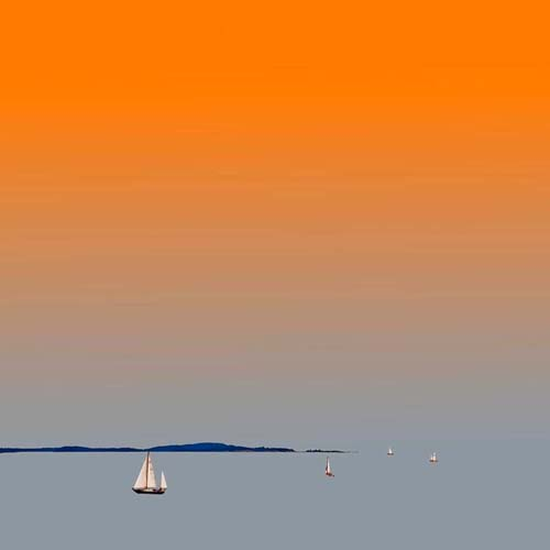 Orange and blue photograph of sailboat on penobscot bay
