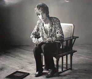 Herb Greene photo of Rod Stewart sitting in chair