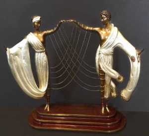 Erte - The Wedding sculpture of bride and groom connected by thin chains