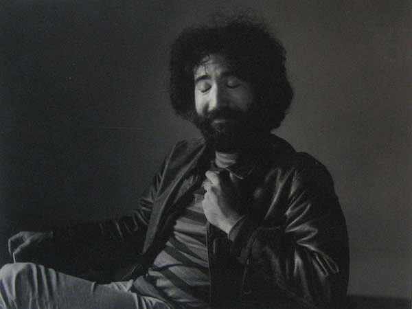 Herb Greene - Jerry Garcia photograph of Jerry garcia in a leather jacket with his eyes closed