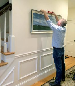 Hanging a painting and making it level
