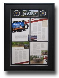 Photo of framed magazine article about a Chris Craft boat restoration