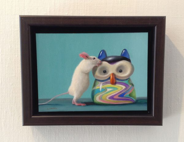 framed Stuart Dunkel painting of a mouse checking out a glass owl with multicolored swirls