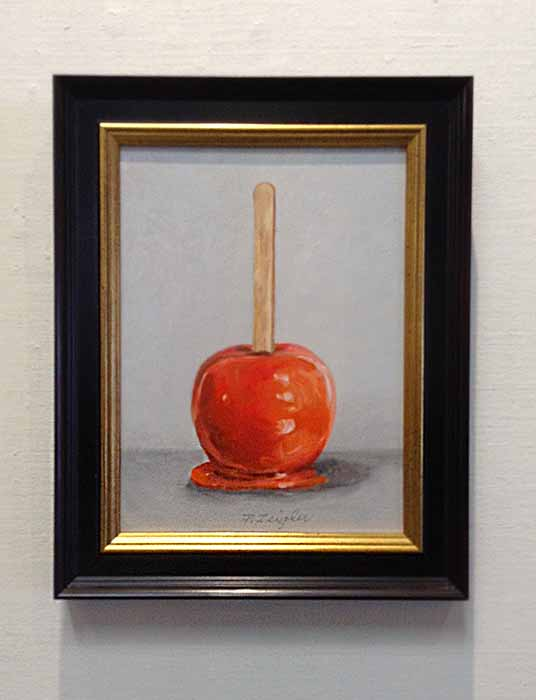 Patti Zeigler framed painting of a candied apple