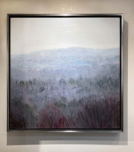 framed Lynne Adams painting of trees and a hill with fog