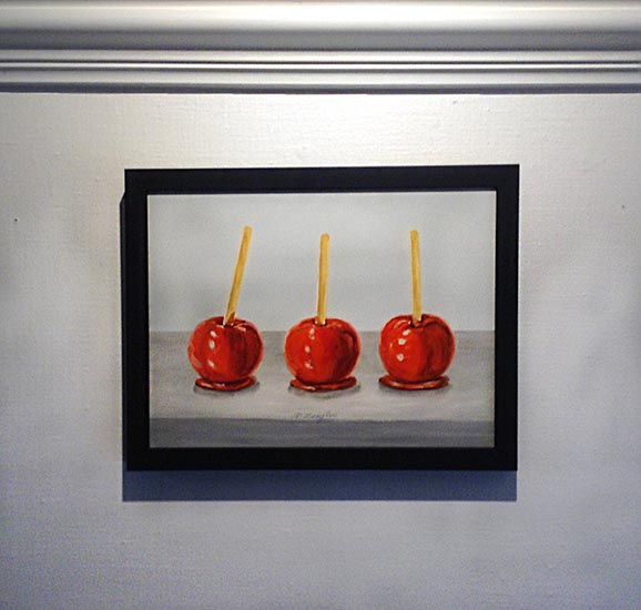 Framed Patti Zeigler painting of 3 red candy apples