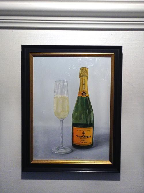 Framed Patti Zeigler painting of champagne in bottle and glass