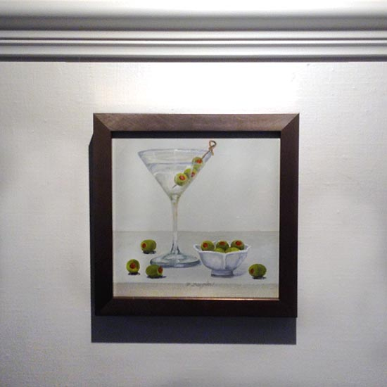 Framed Patti Zeigler painting of martini in glass with olives and bowl