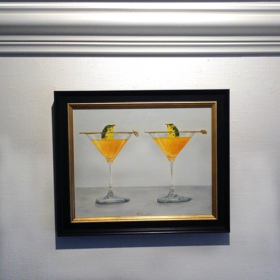 Framed Patti Zeigler painting with 2 orange pineapple martinis in glasses
