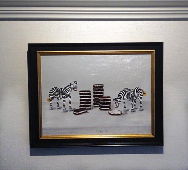 Framed Patti Zeigler painting of mini zebra toys eating stacked oreos