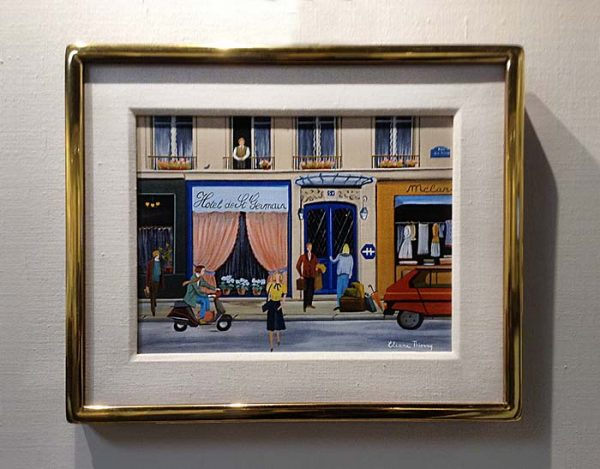Framed Eliane Thierry painting of hotel on busy village street in France