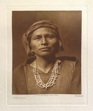 Edward S. Curtis photo of native american man in traditional dress and necklace