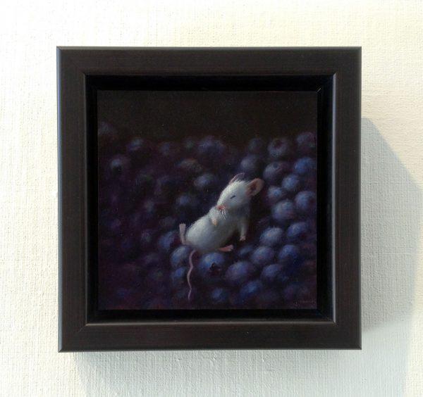 framed Stuart Dunkel painting of mouse sleeping on pile of blueberries