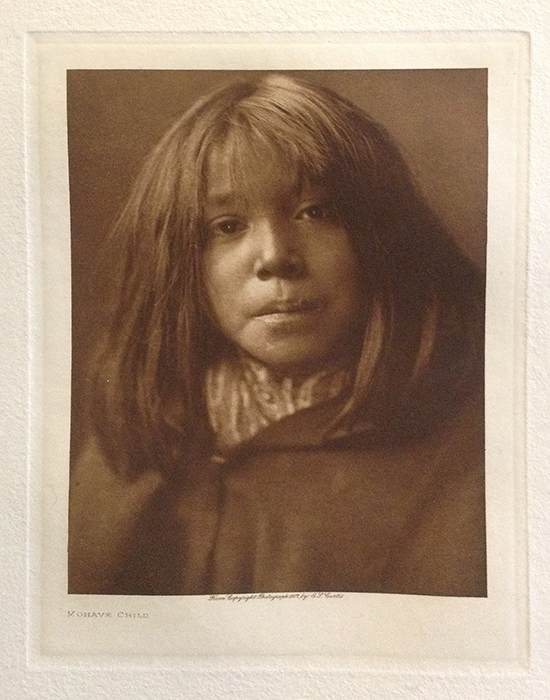 Edward S. Curtis photo os native american child with long hair