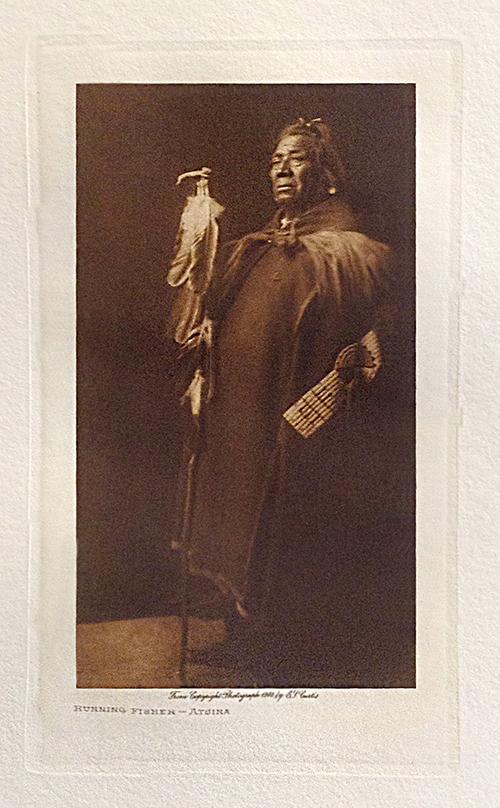 Edward S. Curtis photo of older native american man holding walking stick