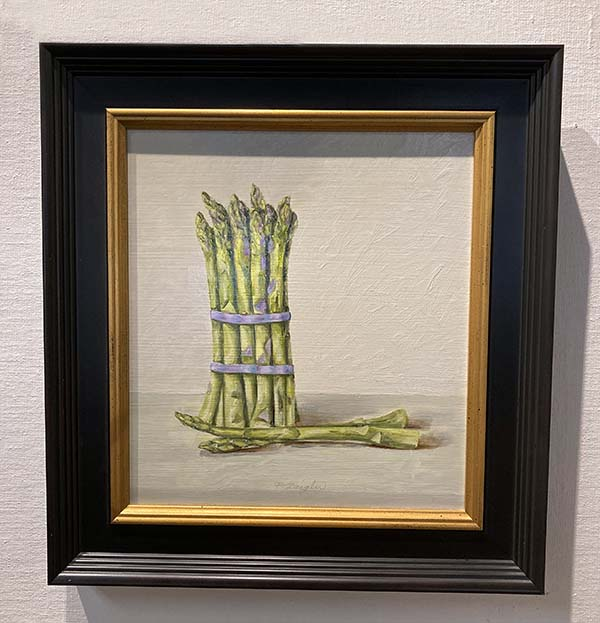 Framed Patti Zeigler painting of a bunch of asparagus