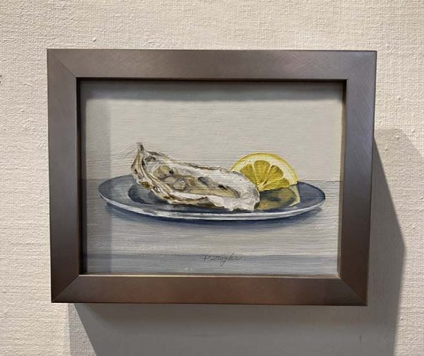 Framed Patti Zeigler painting of a shucked oyster on a plate with lemon slice