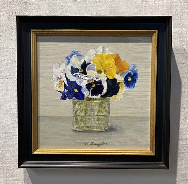 Framed Patti Zeigler painting of pansies in a glass vase