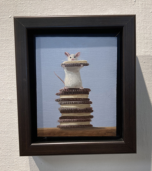 framed Stuart Dunkel painting of a mouse on top of a stack of oreos