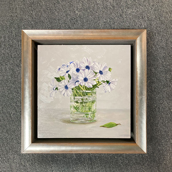 Framed Patti Zeigler painting of daisies in a vase