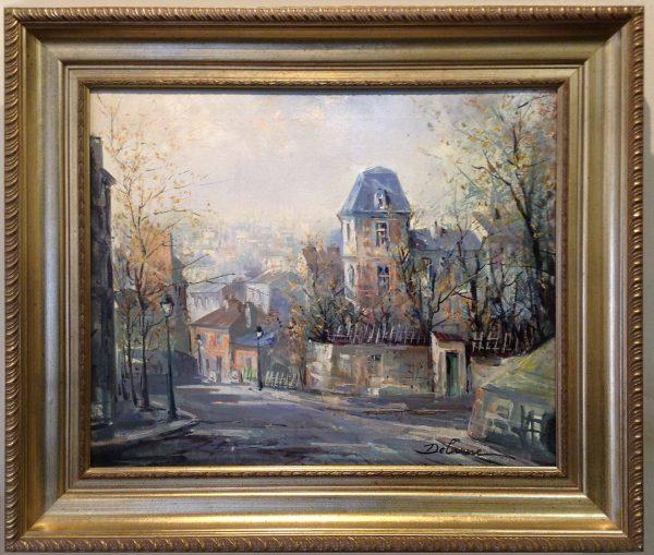 Framed Lucien DeLarue painting of a village street in France
