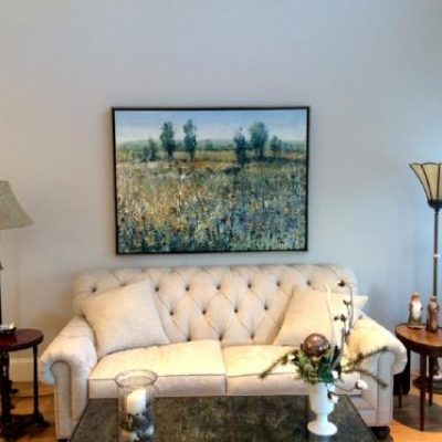 Framed Timothy O'toole landscape hanging over sofa